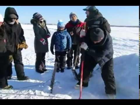 Ice Fishing Demonstration in  Yellowknife.Alberta..Canada.