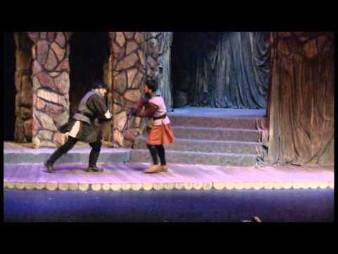 Claudio Venancio as Macduff cutting off Macbeth's head