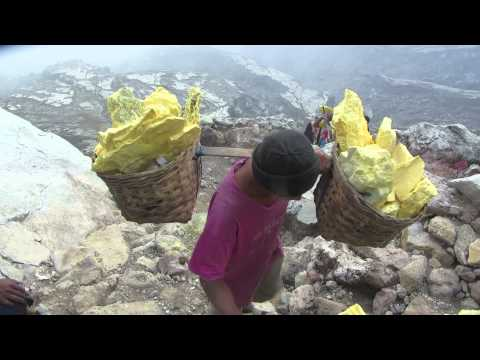 Man Carrying Sulfur Out Of The Ijen Crater