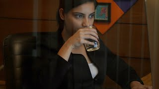Young Indian businesswomen working seriously in the office and drinking water