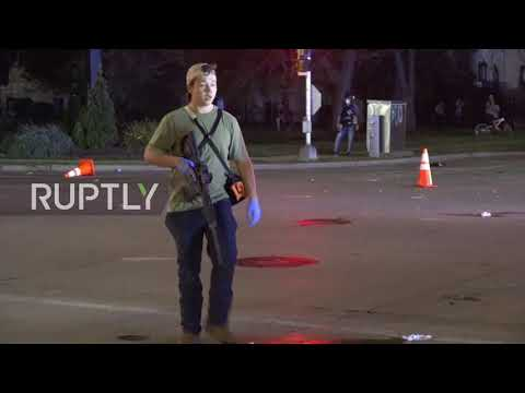 USA: Armed person filmed near site of Kenosha shooting Subscribe to our channel! rupt.ly/subscribe A man was filmed carrying a firearm near the site of a shooting which killed two people and injured one person in ..., From YouTubeVideos