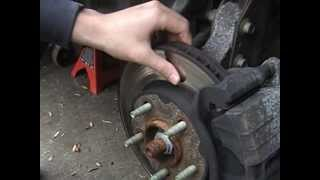 How to Inspect and Replace the Disc Brake Pads and Rotor on a 2003 Pontiac Grand Am