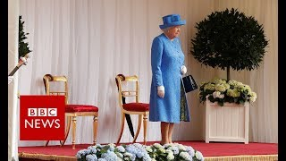 The Queen has emerged on to a dais in Windsor Castle in preparation...