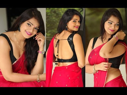 Actress Ashwini In Neted Transparent Sleeveless Black Blouse And Red Saree