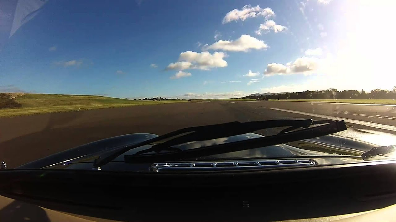 MG RV8 against a TVR Tuscan S3 with Spitfire fly past