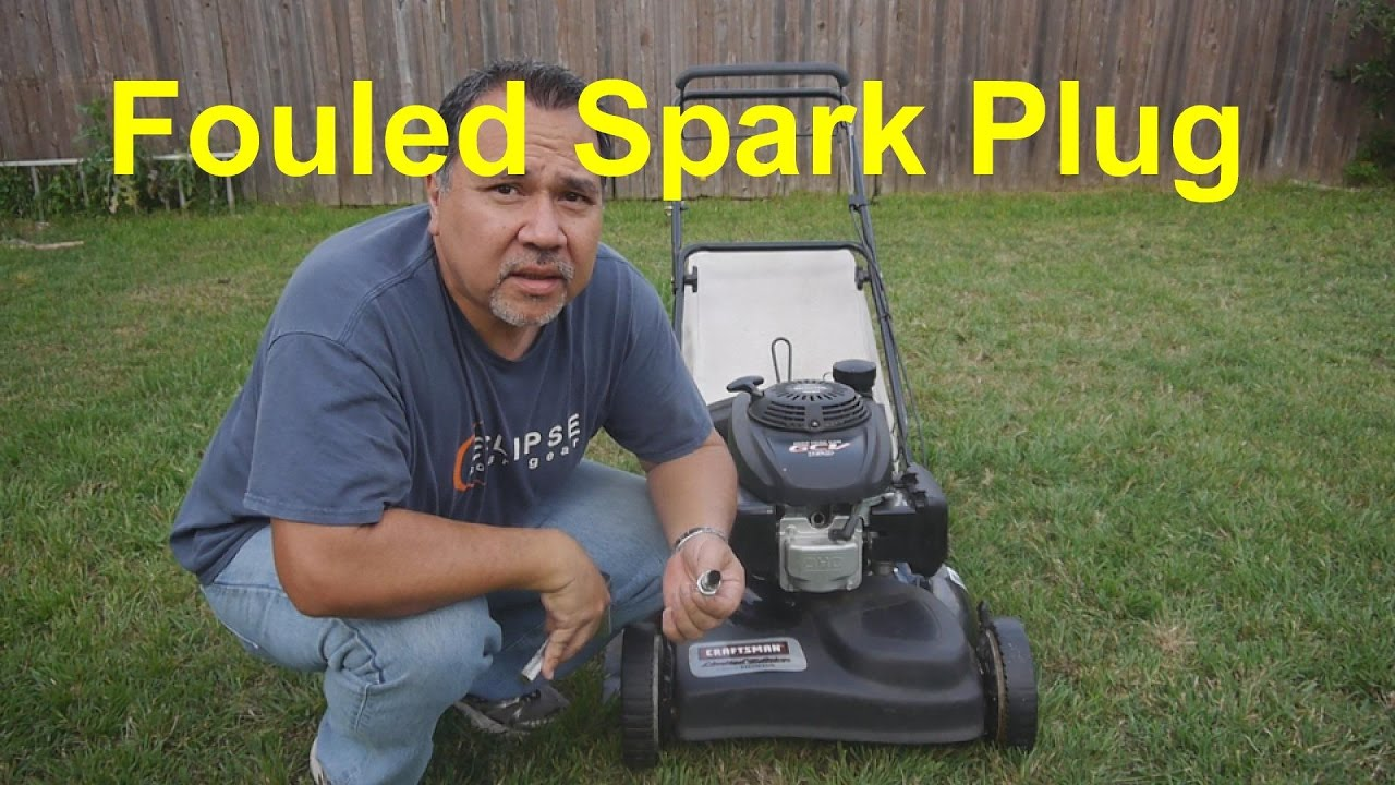 Clean your fouled lawn mower spark plug