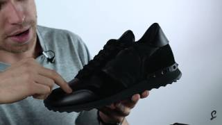 Shop now - http://bit.ly/2ieko7ygeorge unboxes the valentino rockrunner leather and suede with matchesfashion.comvalentino's low-top black trainer...