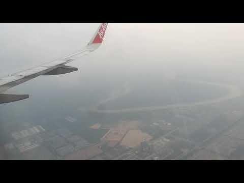 City view of Kualalampur and lending flight by Air Asia