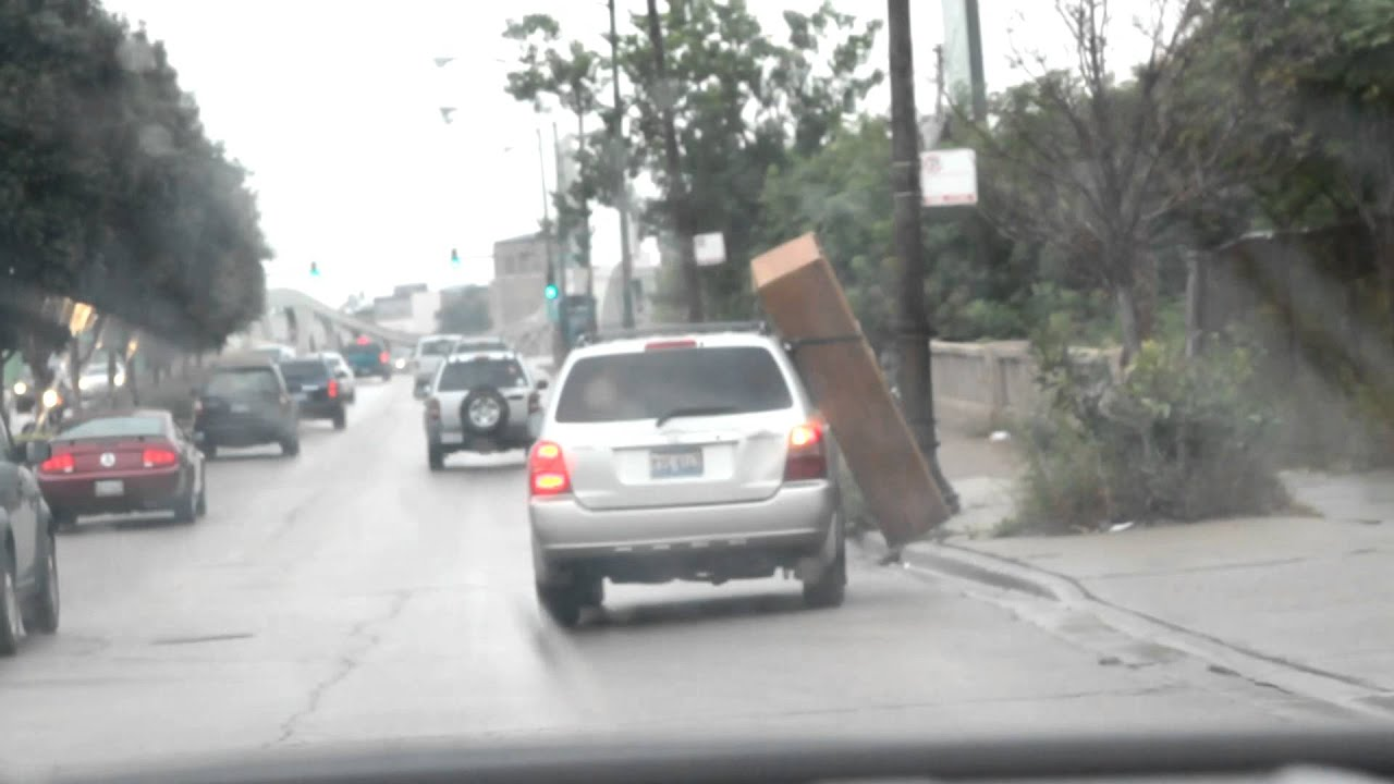 Furniture Falls Off Moving Car In The Rain In Chicago And