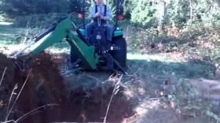 John Deere 47 backhoe digging