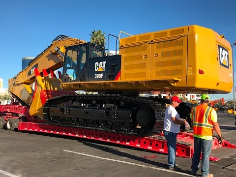 Moving The Massive Cat 390F Excavator From Conexpo