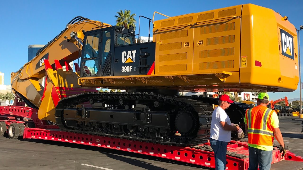 Moving The Massive Cat 390f Excavator From Conexpo Youtube
