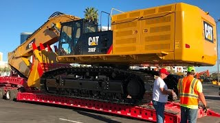 Moving the massive Cat 390F excavator from Conexpo