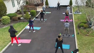 Fitness Instructor Keeps Class Going From Her Driveway