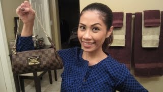 louis vuitton eva clutch what s in my clutch review