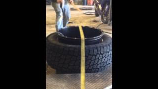 how to stretch a tire on a 22x14 rim