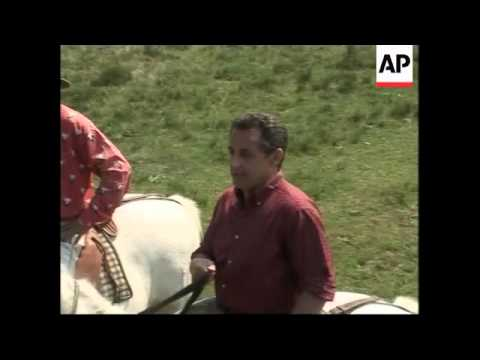 Royal meets shopkeepers in Paris; Sarkozy visits a farm in the south