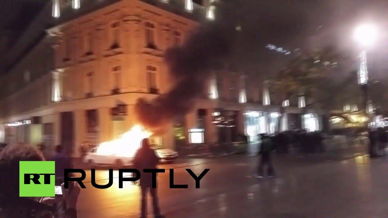 Полицейская машина загорелась в ходе протестов против реформ трудового законодательства в Париже