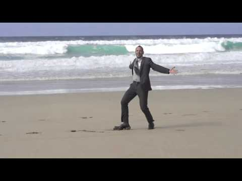 happy businessman dancing on the beach slow motion shot at 60fps 4jgdh1hjx  D