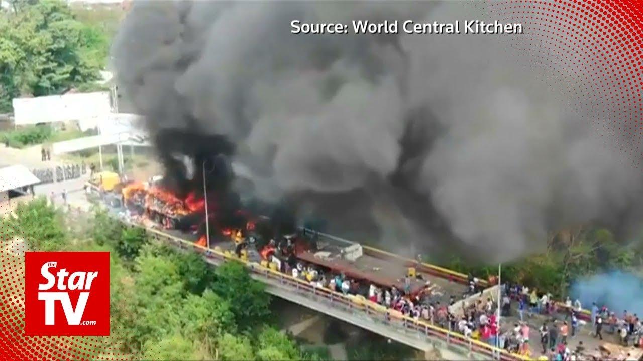 At least two people killed as Venezuela troops block aid