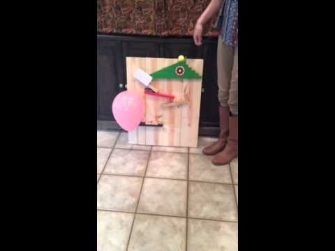 rube goldberg machine popping a balloon