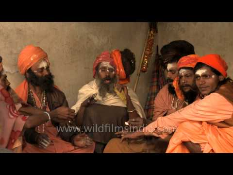 Sadhus smoke marijuana in a chillum