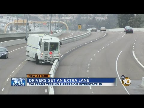 "TRAFFIC: Drivers Get Extra Lane During Rush Hour with ""Zipper"" Barrier-Transfer Machines"