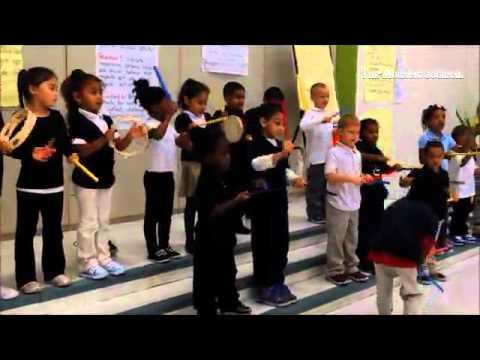 Kindergarten students follow music teacher Dennis Labis's rhythm at Hawthorne Elementary School on 2