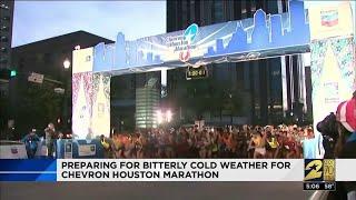 Preparing for the bitterly cold weather for Chevron Houston Marathon