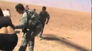 Iraqis get blown away القوات الامريكية تداوي اربعة شباب