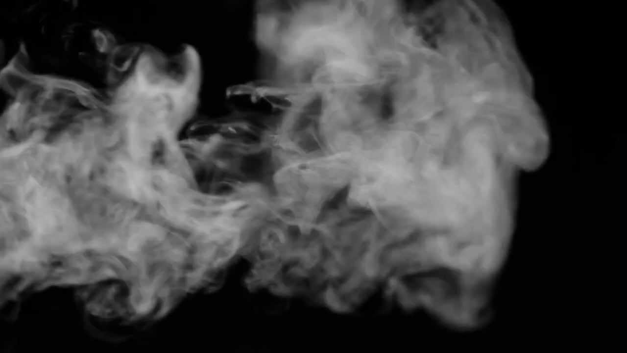Pre-keyed wispy cigarette smoke stock footage (free with download.