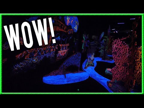 ONE OF THE CRAZIEST AND HARDEST BLACKLIGHT GLOW IN THE DARK MINI GOLF COURSES! - LUCKY HOLE IN ONE