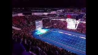 Repeat youtube video U.S. Swimming fans instantly unite to sing the National Anthem when the singer's microphone fails