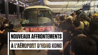 A l'aéroport d'Hong Kong, de nouvelles scènes d'affrontement entre policiers et manifestants