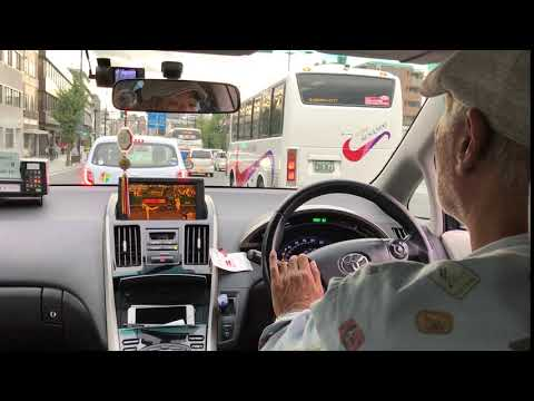 Kyoto Taxi Driver Watching Baseball As He Drives