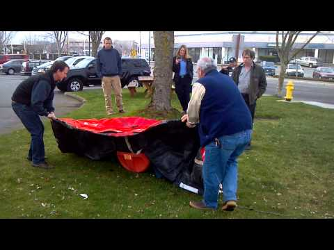 Attempting to Inflate a Survival Life Raft