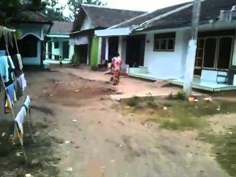 Vitor walking through village in Jember