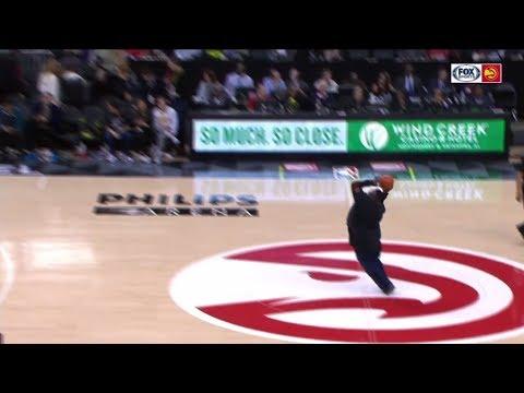 Hawks fan drills half-court shot for $10,000 | ESPN