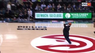 Hawks fan drills half-court shot for $10,000 | ESPN