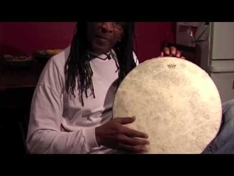 eugene skeef playing  the frame drum for his dinner