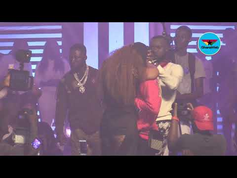 Shatta Wale proposes to Michy at 'Reign' concert; kisses her passionately