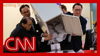 Early Hong Kong election results show pro-government lawmakers losing seats