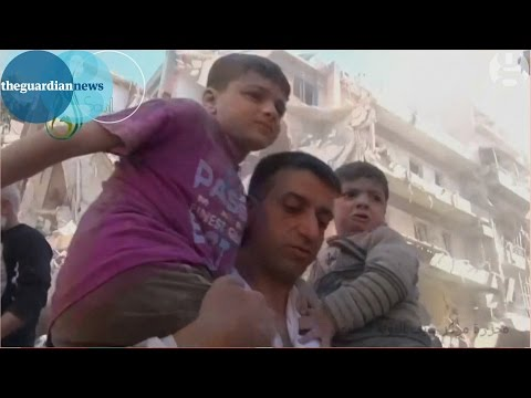 Syria war 2015: Aleppo schoolchildren pulled from rubble of bombed school