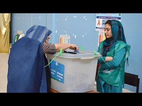 Afghanistan votes in run-off presidential poll in defiance of Taliban