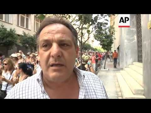 Greek bankers march to parliament in protest at privatisations