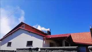 Dym z komina w centrum Gowidlina