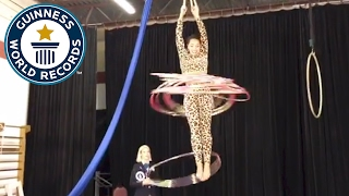 Most hula hoops spun whilst suspended from the wrists - Guinness World Records