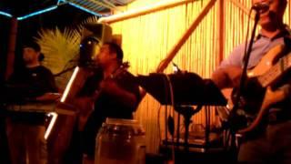 Beach in Hawaii. Local band. Brian
