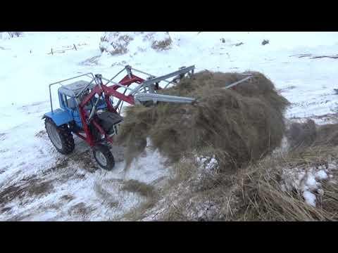Заводим МТЗ 80 Подкидываем сено Коровам.