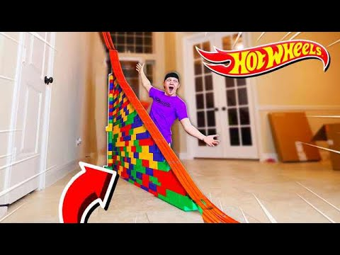 50FT HOT WHEELS RAMP OBSTACLE COURSE!